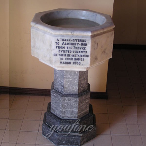 Church interior decor of marble holy water font