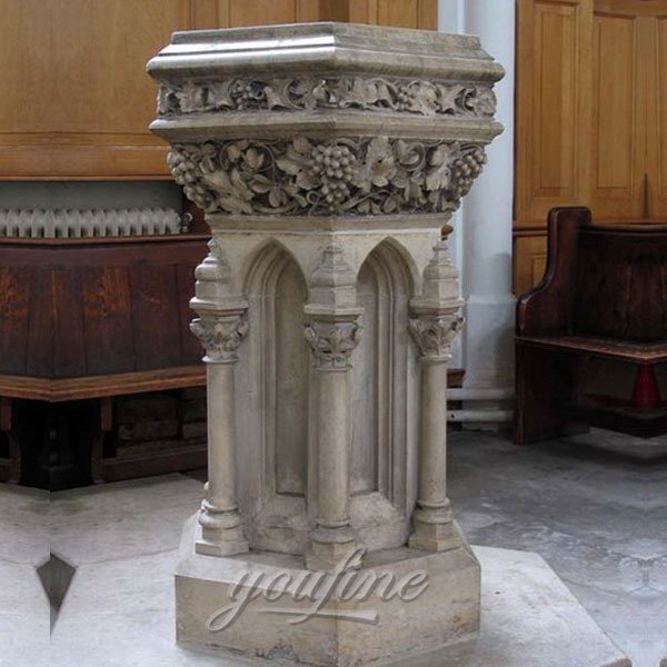 Church interior beautiful antique marble water font with grape and columns decor