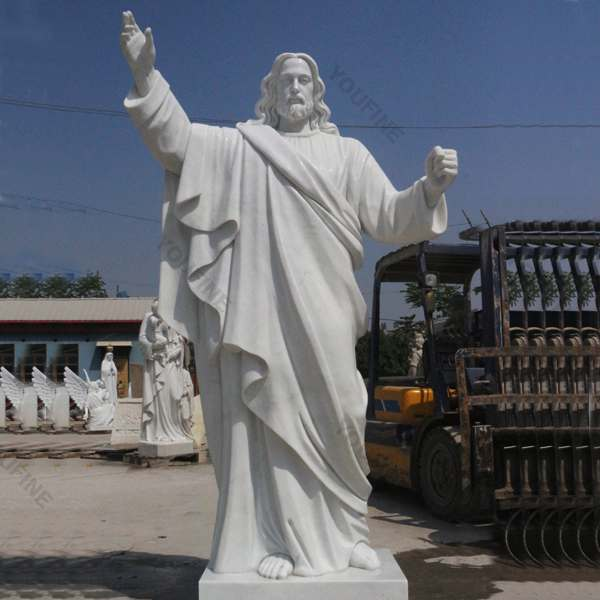 Outside Jaint catholic white marble church statues of christ Jesus making for parish ceremony .jpg